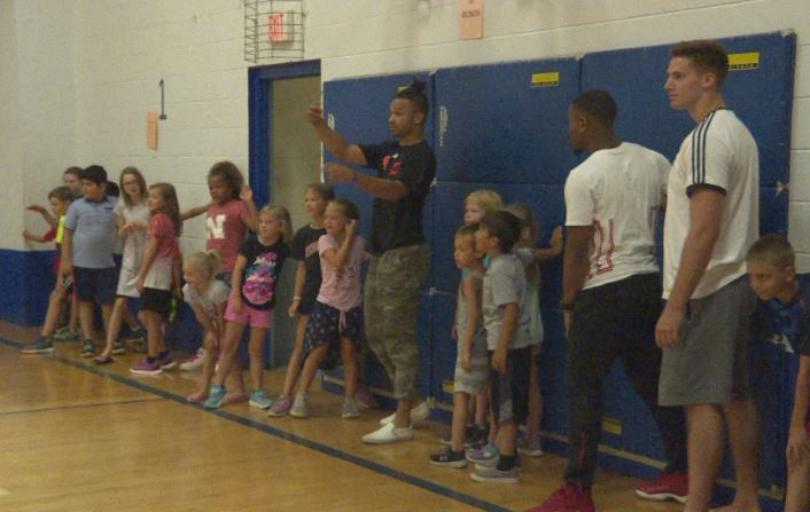 Husker Football Players Volunteer at Belmont Community Center